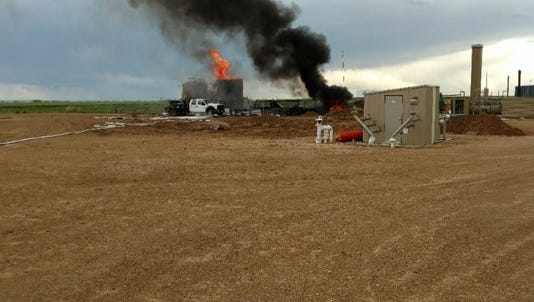 A plume of smoke was visible for miles after a Anadarko oil tank caught fire in Mead Thursday afternoon.