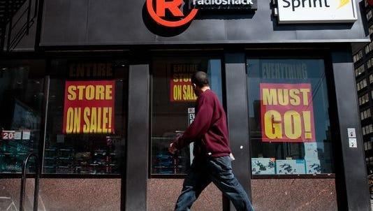 A man walks past a RadioShack storefront in the Chelsea neighborhood of New York.