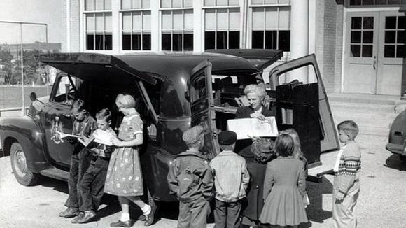 Years, ago the bookmobile provided a different type of summer reader experience. Probably year round, too, judging back the jackets and sweaters.