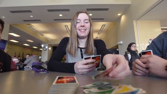 Rachel Bowers of New Milford playing cards with friends at Bergen Community College.
