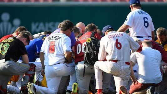 Former Los Angeles Dodgers Steve Garvey leading Republican members of Congress for a moment of reflection before the start of the June 15 Congressional Baseball game.