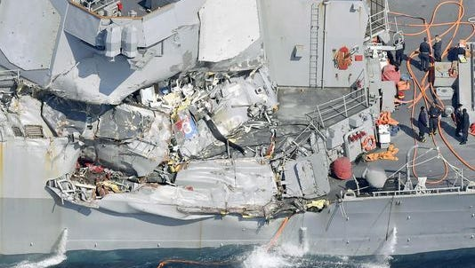 The damaged USS Fitzgerald is shown off the coast of Japan.