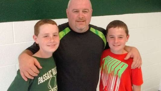 Passaic Valley athletic director Rob Carcich with twin sons Robbie (left) and Michael in 2016.