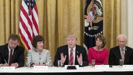 President Trump meets with senators on June 27.