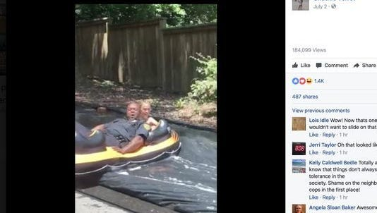 Asheville officers joining in on the slip and slide fun.