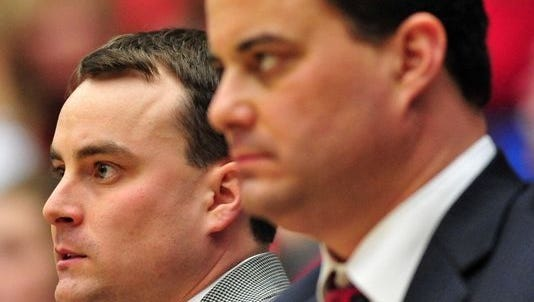 Arizona Wildcats assistant coach Archie Miller (left) sits next to his brother and head coach Sean Miller (right) in the second half against the Arizona State Sun Devils at the McKale Center on January 15, 2011. The Wildcats won 80-69.