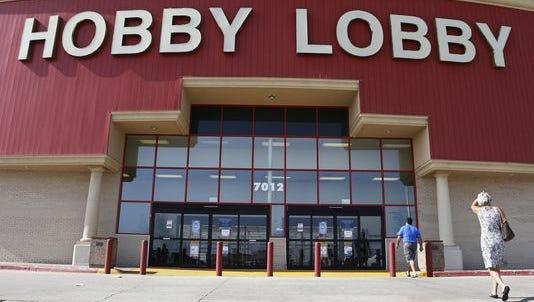 Customers walk to a Hobby Lobby store in Oklahoma City in 2014