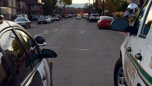 Reno Police and Washoe County Sheriff's officers block East Grove Street near Kietzke Lane on Sunday.