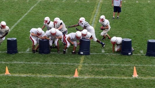 As a way of compensating for declining numbers in his program, Dunellen High School football coach Dave DeNapoli once used garbage cans as linemen to form a makeshift scout team during practice.