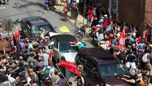 A grey car drives into a group of pedestrians during a white-supremacist rally in Charlottesville, Virginia on Saturday, killing one and injuring 19.
