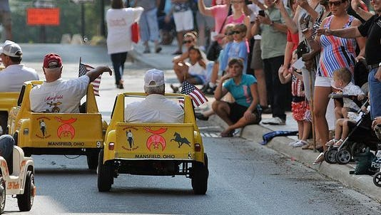 Shriners wave to the crowd during the annual Labor Day Parade.