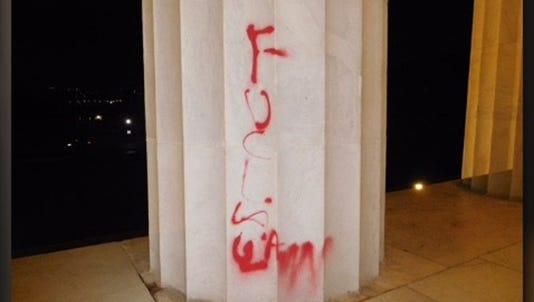 Vandals damaged the Lincoln Memorial with red spray paint. The words 'F*** law' appeared to be written on a column, the National Park Service said.
