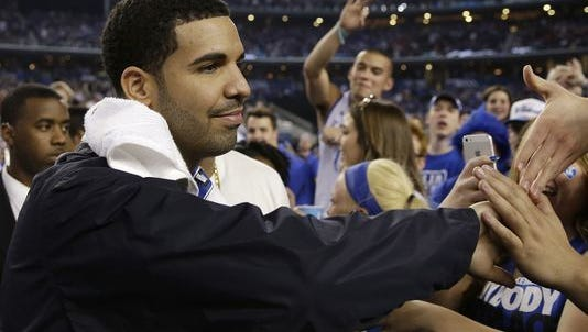 Drake greets University of Kentucky basketball fans at halftime of a 2014 game.
