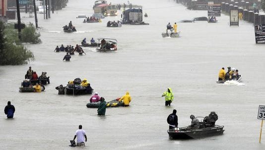 Rescue boats fill a flooded street from Tropical Storm Harvey on Aug. 28, 2017, in Houston.