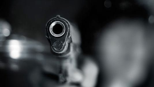 Close-up stock image of a semi-automatic handgun.