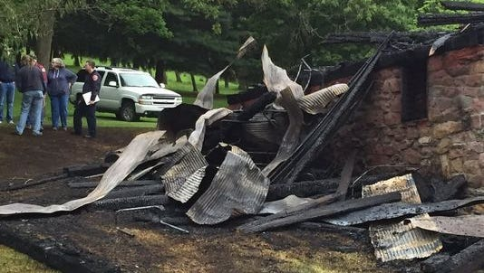 Police have charged two men in connection with this May 21 barn fire in East Manchester Township.