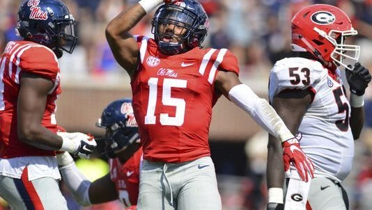 Ole Miss defensive back Myles Hartsfield gives the landshark gesture that some want to make the official mascot.