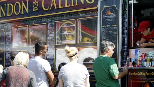 People wait in line for London Calling during lunch hour at its SGF Mobile Food Park location.