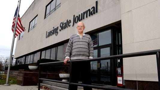 Jim Hough stands in front of the former Lansing State Journal building in December 2015. He worked for the Journal for three decades, penning an estimated 9,000 columns.