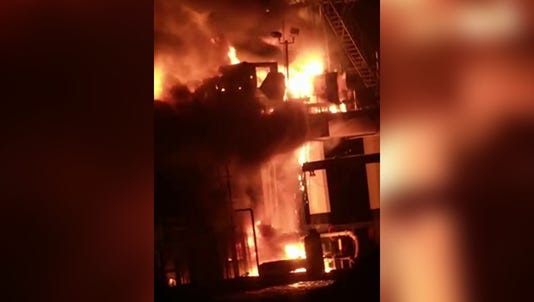 A fire continues to burn on an oil platform in Lake Pontchartrain more than nine hours after an explosion Sunday night that injured several people.