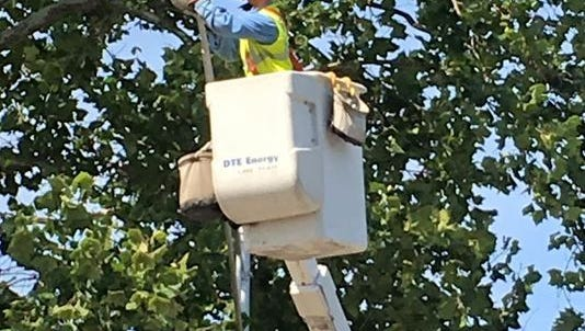 DTE worker converting a mercury vapor street light to LED.