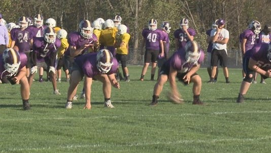 Albion High football players practice.