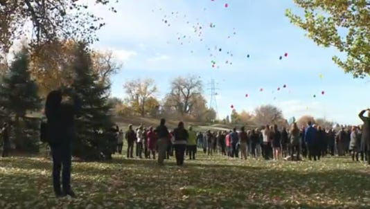 Friends and family release balloons in Savannah McNealy's honor in deKoevend Park in Centennial on Monday, Oct. 23, 2017.