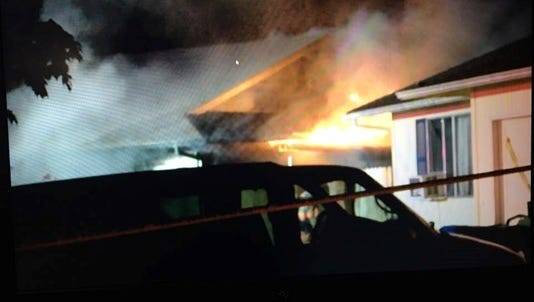 A two-alarm fire at a Keizer home critically injured a 6-year-old girl and her father Thursday night.