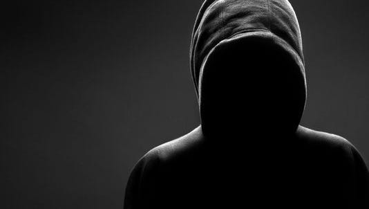 Stock image of someone in a hooded sweatshirt.