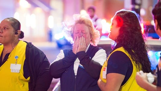 An employee at the Thornton Wal Mart store reacts to the Nov. 1 shooting, which left 3 dead.