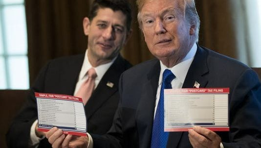 House Speaker Paul Ryan and President Trump on Nov. 2, 2017, show what tax forms could look like