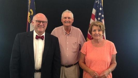 Don Collins, center, is the newly elected mayor of Black Mountain.