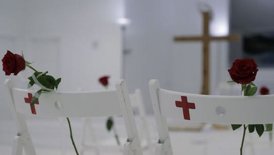 A memorial at the First Baptist Church in Sutherland Springs, Texas, on Nov. 12,  includes 26 white chairs for those who died in mass shooting.