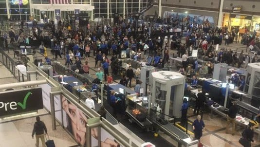 Crowds gather in Denver International Airport for holiday travels.