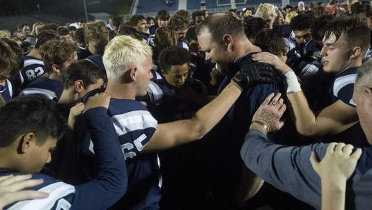 A national advocacy group says Reitz football coach Andy Hape's prayer with his team broke constitutional religious laws. Noah Stubbs / Evansville Courier & Press