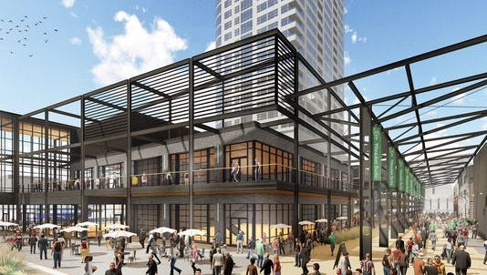 A revised design for the future entertainment center near the Milwaukee Bucks new arena won unanimous approval from the Plan Commission on Monday.