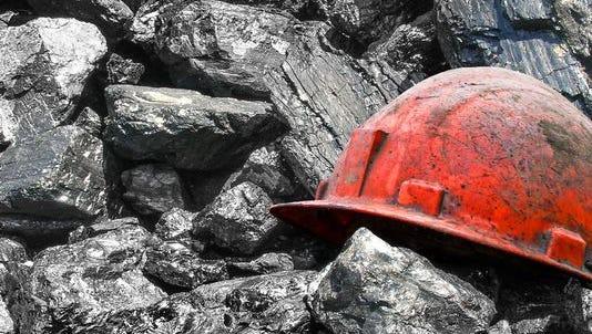 A miner's helmet atop chunks of coal