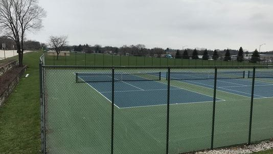 Nicolet High School's tennis courts and soccer practice field are being sold to a hotel and retail developer.