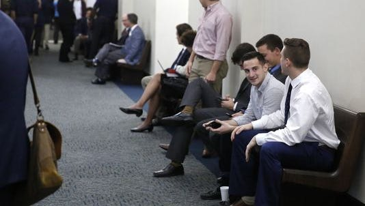 FSU students wait in the halls at the Leon County Courthouse recently to be questioned by the grand jury investigating the death of fraternity pledge Andrew Coffey.