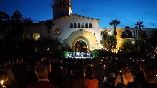 Thousands of people gathered for a candlelight vigil Jan. 14, 2018, in Santa Barbara, Calif., to mourn the victims of the Montecito mudslides.