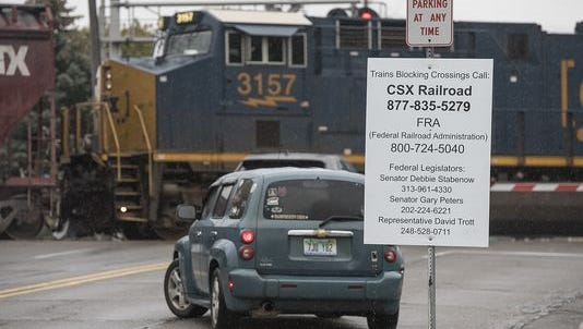 The problem of blocked railroad crossings has eased in recent weeks, local officials say.