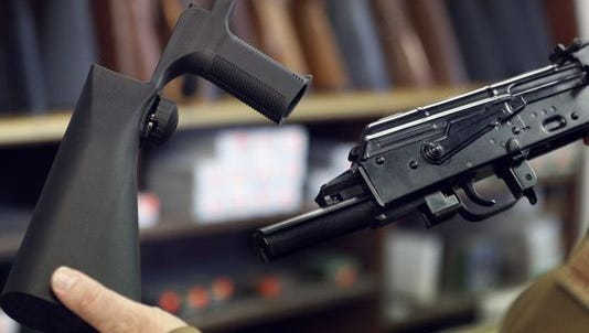A bump stock is displayed.
