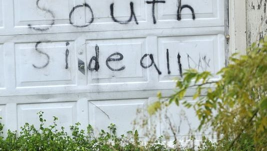 A garage with what appears to be a Southside gang tag, seen here in November 2015, is along East Maple Street in York. Twelve members of the gang were convicted of drug-related charges in federal court.