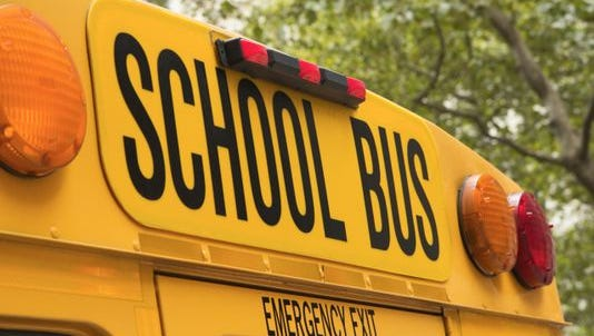 A motorist died in Monroe Monday when a school bus collided with a car at a Route 322 intersection.