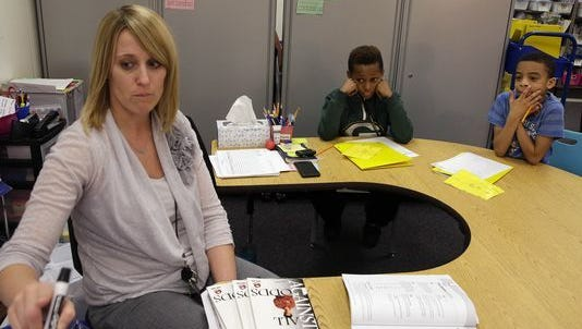 Teacher Rebecca Olson works with Andrae Staples and Ameer Stone on reading and word construction during classes at Brown Deer Elementary School. An open house was held recently to discuss a proposed referendum that could help address overcrowding at the school.