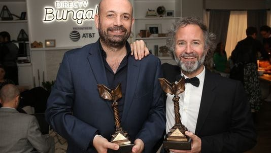 Director Antonio Méndez Esparza (L) and producer Pedro Hernandez Santos, winners of the John Cassavetes Award for 'Life and Nothing More,' pose at the DIRECTV BUNGALOW presented by AT&T at the 2018 Film Independent Spirit Awards on March 3, 2018 in Santa Monica, California.
