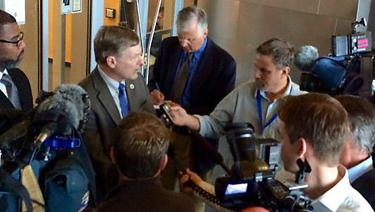 Seattle City Attorney Pete Holmes speaks with reporters in this 2014 photo. Holmes has asked the city's judge to consider throwing out minor marijuana convictions.
