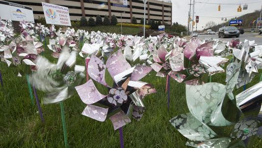 In this file photo, pinwheels representing victims of child abuse are displayed outside York Hospital.