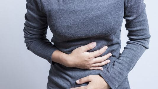 Colon cancer signs can include persistent cramps and changes in bowel habits, along with bloody stools.