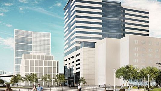A rendering shows the office tower under construction along the Camden Waterfront.